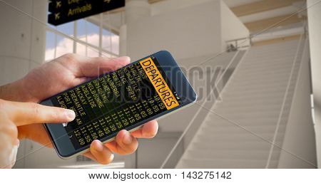 hand holding smartphone against airport terminal