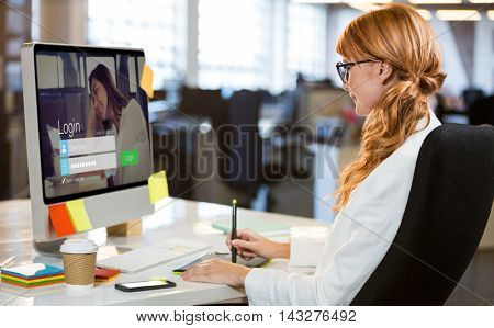 Login screen with dark-haired woman and laptop against businesswoman using graphics tablet at desk