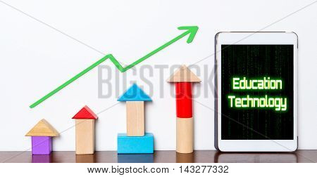 Education technology make your successfully rising up. Toy block colorful graph rising up as Technology being use in Education industry.