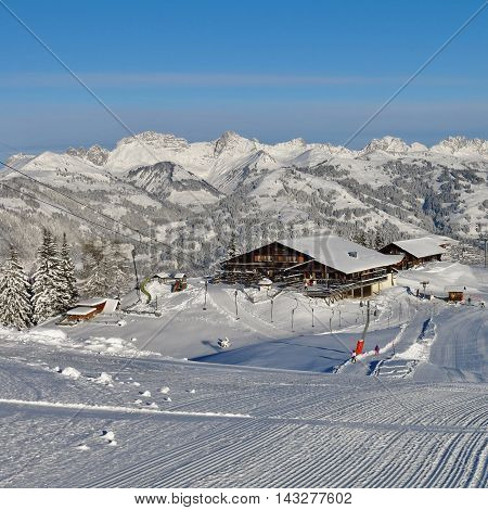 Summit station and restaurant on top of Mt Wispile. Ski area in Gstaad. Snow covered mountains.
