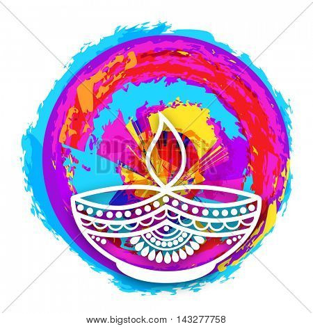 Floral design decorated Oil Lit Lamp (Diya) on colorful abstract background for Indian Festival of Lights, Happy Diwali celebration.