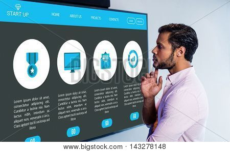 Various icons on website against thoughtful man looking over whiteboard