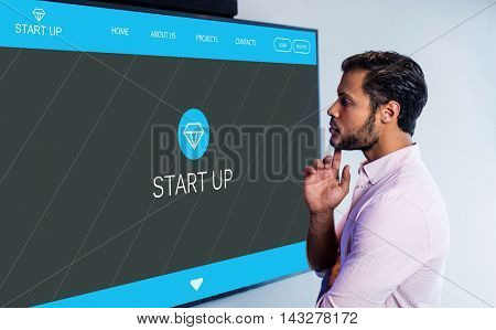 Main web page on startup website against thoughtful man looking over whiteboard