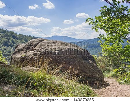 Rock in front of woody hills in the Giant Mountains Silesia Poland