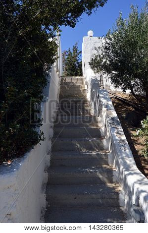 One staircases of concrete decorated with two walls white.
