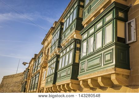 Valletta, Malta - Traditional green balconies in the sunset at the capital of Malta