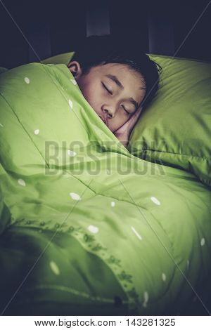 Healthy Child. Little Asian Boy Sleeping Peacefully On Bed. High Contrast Style.