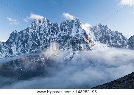 View of Lobuche Peak from Kala Patthar above clouds Solu Khumbu Nepal.