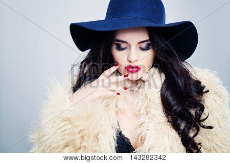 Glamorous Fashion Model Woman in Blue Hat