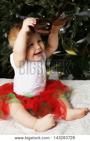 Baby with christmas background. Happy New Year!