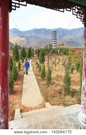 Heqing, China - March 16, 2016: Man Walking In The Complex Of The Heyang Temple In Heqing, Yunnan In