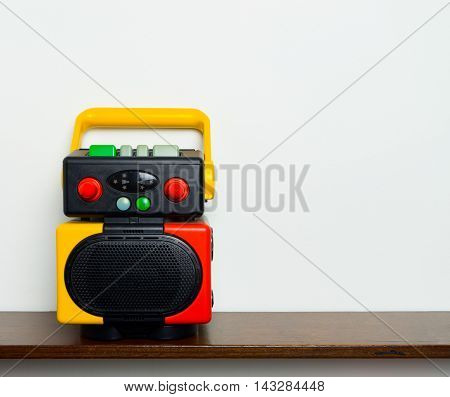 Retro Colorful Robot Boom box music player on wooden shelf with copy space