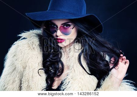 Glamorous Woman with Curly black Hairstyle on dark
