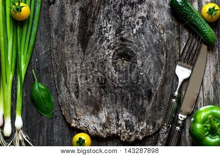 Frame Of Fresh Vegetables And Herbs On Wooden Background.