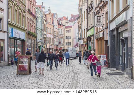 JELENIA GORA POLAND - AUGUST 17 2016: Tourists Walking Through Historic Downtown in Jelenia Gora Poland