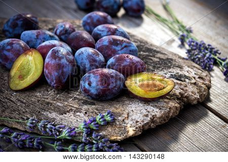 Fresh Plums On Wooden Background