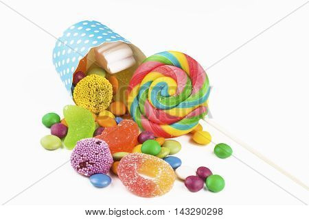Colorful delicious mixed candies, on a white background.