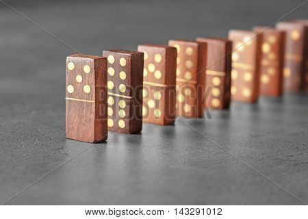 Wooden dominoes on grey table