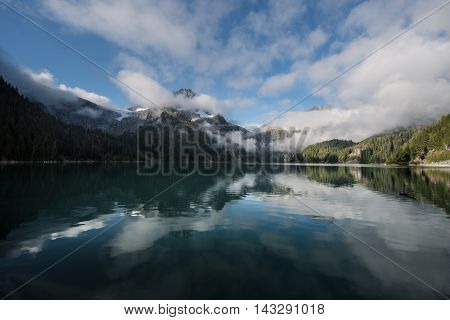 Morning mist on an alpine lake in squamish