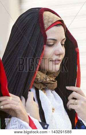 SELARGIUS, ITALY - September 14, 2014: Former marriage Selargino - Sardinia - portrait of a beautiful girl in traditional Sardinian costume