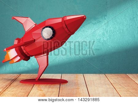 Red toy rocket on the wooden table. 3d rendering