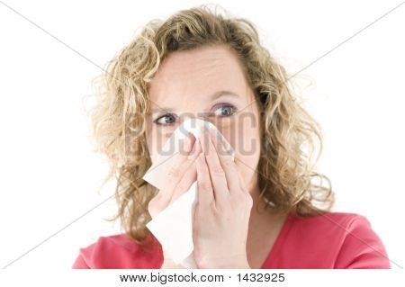 Young Blond Girl Sneezing In The Handkerchief