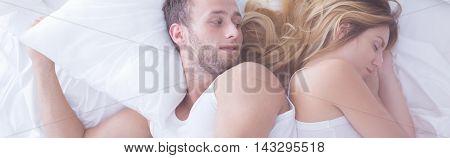 Man Looking At Sleeping Girlfriend