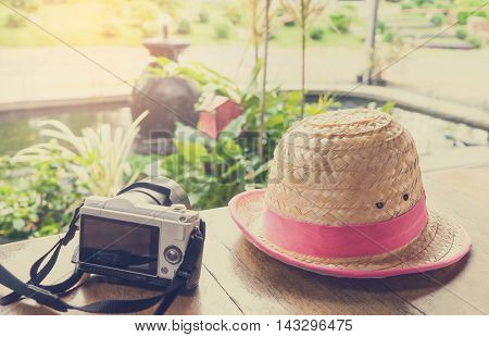 Camera and Farm hat travel with family memories background.