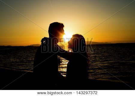 At sunset seaside dear young couple in love.