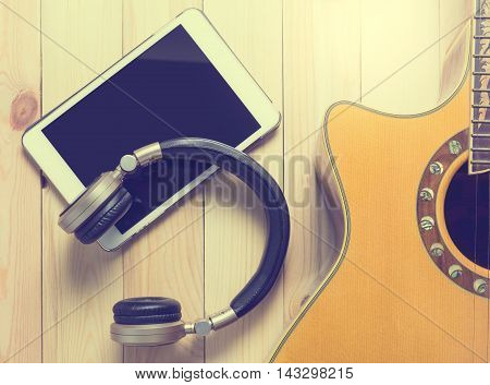Music listening and practicing with tablet and guitar