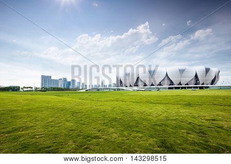 hangzhou,china: hangzhou olympic stadium from empty grassland with sunbeam by zhudifeng on June,4,2016