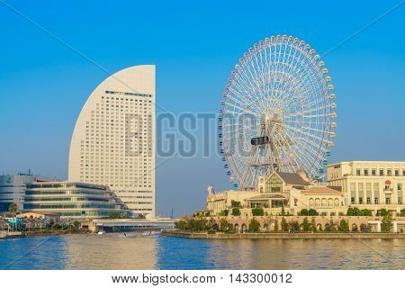 Yokohama,Japan - November 24,2015 : Ferris wheel at cosmo world fun park at minato mirai , Yokohama is the third biggest city in Japan.