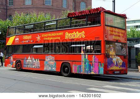 FRANKFURT AM MAIN GERMANY - AUGUST 7 2015: A double-decker tourist sightseeing bus at Paulsplatz square in the Old Town.