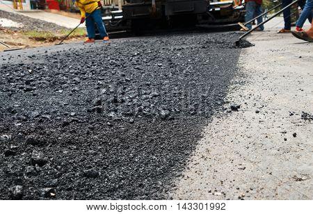 Close-up asphalt at the road under construction.