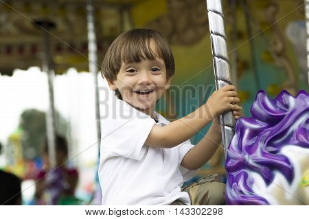Happy Boy Having Fun Riding