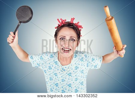 Crazy Housewife With Rolling Pin And Pan