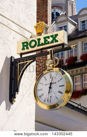 MUNICH GERMANY - AUGUST 3 2015: The logo of the brand Rolex. It was founded in London UK in 1905 and moved its base of operations to Geneva Switzerland in 1919.