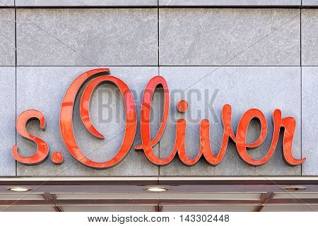 MUNICH GERMANY - AUGUST 3 2015: The logo of the brand s. Oliver. A German fashion company headquartered in Rottendorf that sells apparel shoes accessories jewellery fragrances and eyewear worldwide.