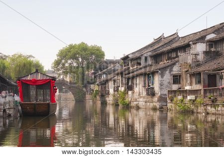 The buildings and water canals of Fengjing Town in Shanghai China on a sunny blue sky day.