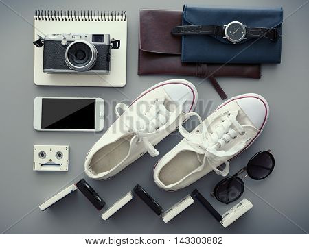 Top view of clothing and personal accessory on the grey background