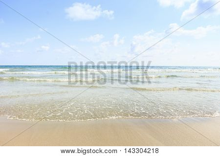 Beautiful water nature. Perfect summer resort for relax. Sea waves near beach. Beautiful sea beach. Summertime, blue sea and waves, yellow sun and sand.