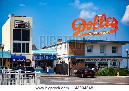 Rehoboth Beach DE - June 25 2013: The big orange Dolles Salt Water Taffy sign on top of the candy shop has become a Delaware landmark.
