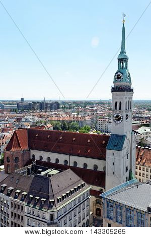 Cityscape of Munich Bavaria Germany seen from the top of city hall. St. Peter's Church a Roman Catholic church the oldest one in the district.