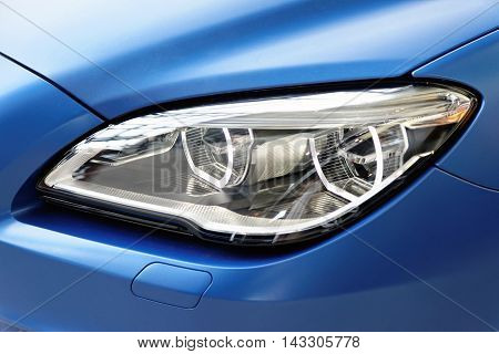 Head lights of modern car made in Europe.