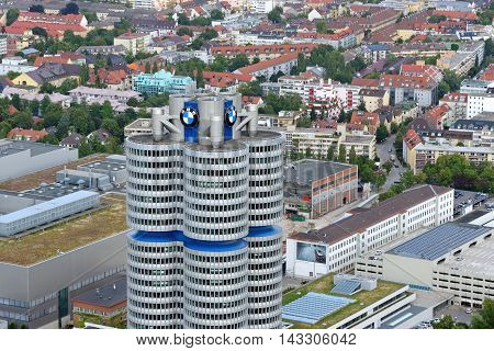 MUNICH GERMANY - AUGUST 4 2015: Opened in 1973 the BMW four cylinder tower (BMW Hochhaus Vierzylinder) is the world headquarters of German auto maker BMW.
