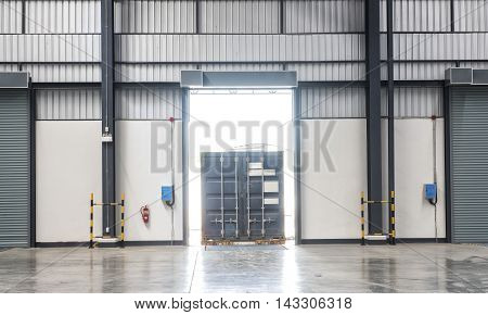 Container box on truck at loading dock shipping industry warehouse