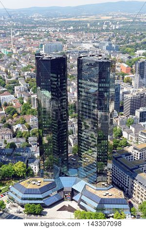 FRANKFURT AM MAIN GERMANY - AUGUST 6 2015: Aerial view of the Deutsche Bank skyscraper from the observatory deck of the Mian tower skyscraper. Frankfurt is the largest financial centre in continental Europe.
