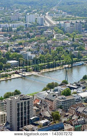 Aerial view of Holbeinsteg bridge over the river Main in Frankfurt am Main Germany. It is a pedestrian suspension bridge with the
