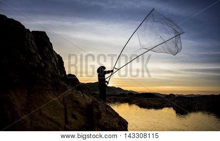Silhouette of fishermen River Sunrise in Thailand