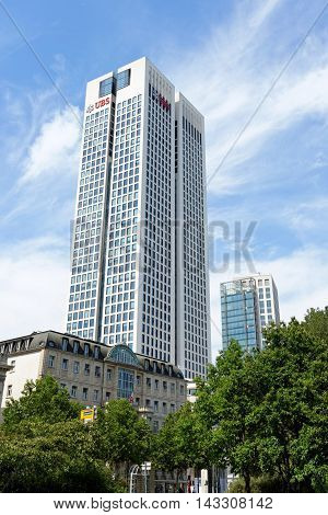 FRANKFURT AM MAIN GERMANY- AUGUST 6 2015: Opernturm (Opera Tower) skyscraper with UBS logo. UBS is a Swiss global financial services company headquartered in Zurich Switzerland.